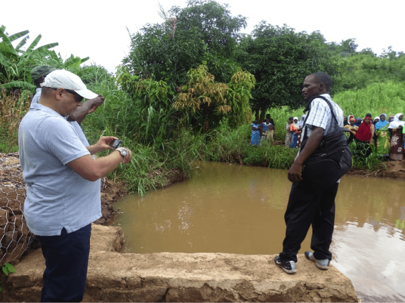 Brother Ashraf Patel - Representative of Peace and Relief International inspecting the main intake area that shares water to both Nakawale and Pachibale irrigation schemes.